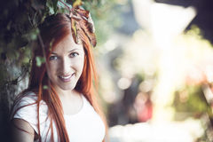Portrait of red head woman. Portrait of attractive smiling red head woman outdoors Stock Image