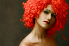 Portrait in a red wig Royalty Free Stock Photos