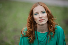Portrait of redhair girl in green dress Stock Images