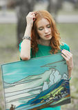 Portrait of redhair girl in green dress with fresco in her hands Stock Photos