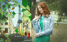 Portrait of redhair girl in green dress near fresco Stock Images