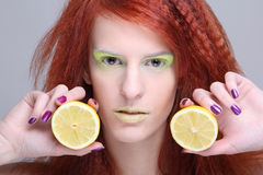 Portrait of redhaired girl with lemon Stock Photos