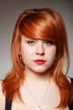 Portrait redhaired girl young woman with cherry earing on gray Stock Photo
