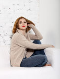 Portrait of the redhaired woman. On the sofa Stock Images