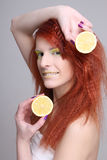 Portrait of redhaired woman with lemon Stock Photos