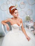 Portrait of redhead bride in the interior. Stock Photography