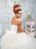 Portrait of redhead bride in the interior. Stock Images