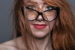 Portrait of a redhead freckled girl Stock Image
