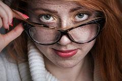 Portrait of a redhead freckled girl Stock Photography