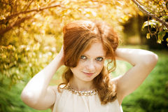 Portrait of redhead girl with blue eyes on nature Royalty Free Stock Images