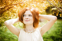 Portrait of redhead girl with blue eyes on nature Royalty Free Stock Image