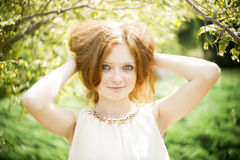 Portrait of redhead girl with blue eyes on nature Stock Images