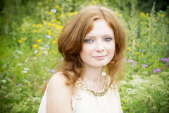 Portrait of redhead girl with blue eyes on nature Stock Image