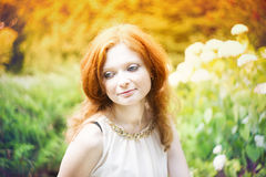 Portrait of redhead girl with blue eyes on nature Stock Photography