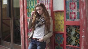Portrait of a redhead girl in casual clothes on the background colored walls. young girl hipster. 20s. Closeup portrait of a beautiful red-haired girl. hair stock video footage