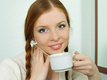 Portrait of redhead girl drinking coffee Royalty Free Stock Images