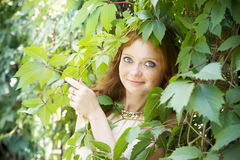Portrait of redhead girl on nature Royalty Free Stock Images