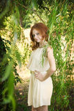 Portrait of redhead girl on nature Royalty Free Stock Photos