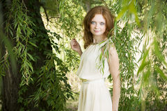 Portrait of redhead girl on nature Royalty Free Stock Photography
