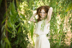 Portrait of redhead girl on nature Stock Image