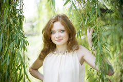 Portrait of redhead girl on nature Royalty Free Stock Photo
