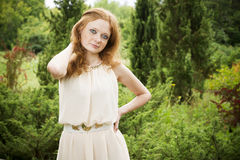 Portrait of redhead girl on nature Royalty Free Stock Image