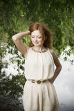 Portrait of redhead girl on nature Stock Images