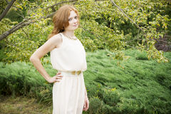 Portrait of redhead girl on nature Stock Photography