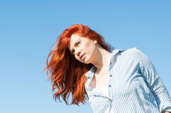 Portrait of redhead girl relaxing on sunny day Stock Photos