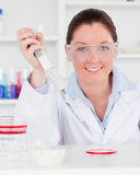 Portrait of a redhead scientist preparing a sample Stock Photo