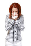 Portrait of a redhead woman with handkerchief. Woman blowing her nose isolated on white Royalty Free Stock Photo