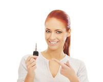 Portrait of a redhead woman holding a car key Stock Photography