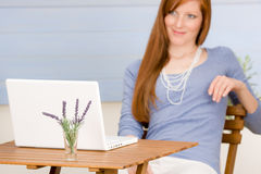 Portrait redhead woman with laptop on terrace Royalty Free Stock Images