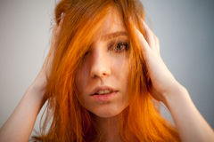 Portrait of redhead woman in soft focus Stock Photos
