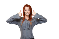 Portrait of a redhead woman with thumbs up Royalty Free Stock Image