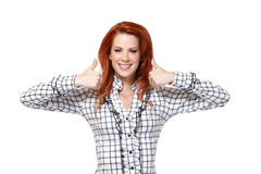 Portrait of a redhead woman with thumbs up Royalty Free Stock Photos