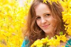 Portrait of redhead woman in yellow. Bloom flowers with dandellions royalty free stock images