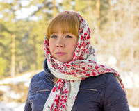 Portrait of a redheaded girl in a bright scarf. Stock Image