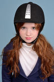 Portrait of redheaded girl jockey Stock Photo