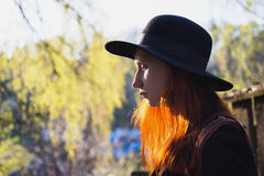Portrait of a redheaded girl with natural light on the background of nature in spring Royalty Free Stock Image