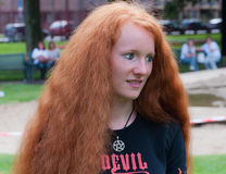Portrait of a redheaded young woman. BREDA, NETHERLANDS – SEPTEMBER 4, 2011 : Redhead Day for young and old in the Dutch city of Breda. Thousands of redheads Stock Image
