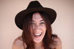 Portrait of a relaxed beautiful woman wearing a stylish hat Royalty Free Stock Photography