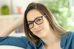 Portrait of a relaxed beauty woman wearing eyeglasses. Looking at camera at home Royalty Free Stock Photos