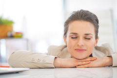 Portrait of relaxed business woman in office Stock Photos