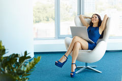 Portrait of relaxed business woman in office. Relax and freedom. Concept Stock Photos