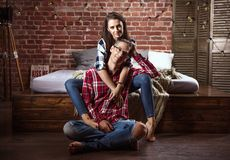 Portrait of a relaxed cheerful couple in a modern interior royalty free stock image