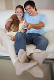 Portrait of a relaxed couple watching television Royalty Free Stock Photography