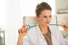 Portrait of relaxed doctor woman in office Royalty Free Stock Photography