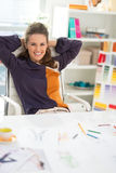 Portrait of relaxed fashion designer in office Royalty Free Stock Image