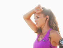 Portrait of relaxed fitness young woman in headphones outdoors Stock Photo